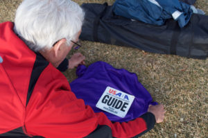 running guide pinning guide bib to hsu race shirt